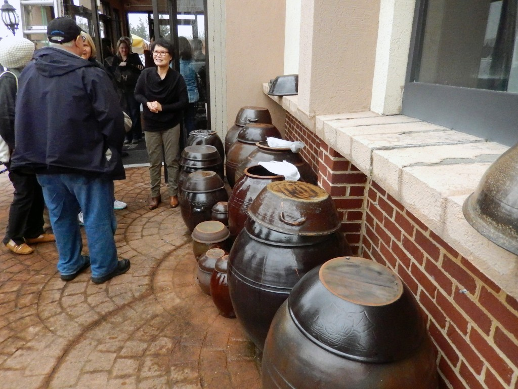 Owner Showing Sauce Pots