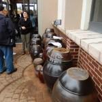 Owner Showing Sauce Pots